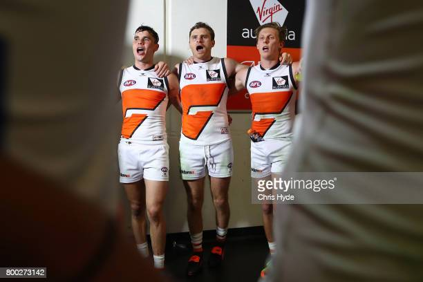 Giants sing the team song after playing his 250th match during the round 14 AFL match between the Brisbane Lions and the Greater Western Sydney...