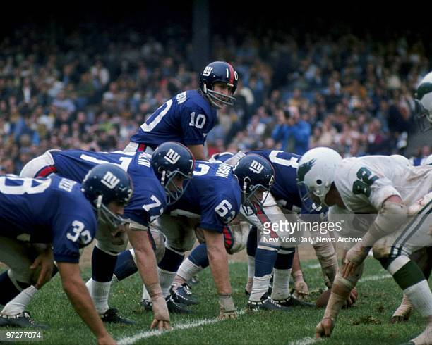 Y Giants star quaterback Fran Tarkenton prepares to take the snap from center in a game against the Philadelphia Eagles at Yankee Stadium circa 1969