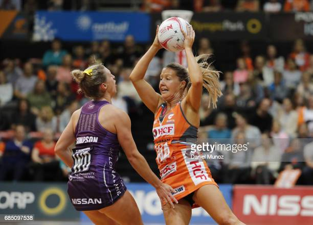 Giants wing attack Sarah Wall passes the ball evading Firebirds Gabi Simpson during the round 13 Super Netball match between the Giants and the...