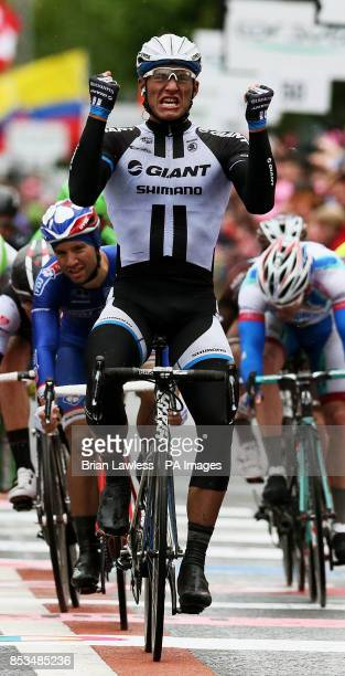GiantShimano's Marcel Kittel celebrates as he crosses the finish line to win Stage two of the 2014 Giro D'Italia in Belfast
