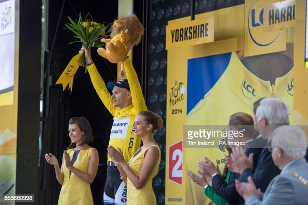 GiantShimano's Marcel Kittel celebrates putting on the yellow jersey after winning stage one of the Tour de France in Harrogate Yorkshire