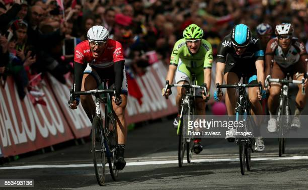 GiantShimano's Marcel Kittel crosses the finish line to win stage three of the 2014 Giro d'Italia from Armagh to Dublin Republic of Ireland