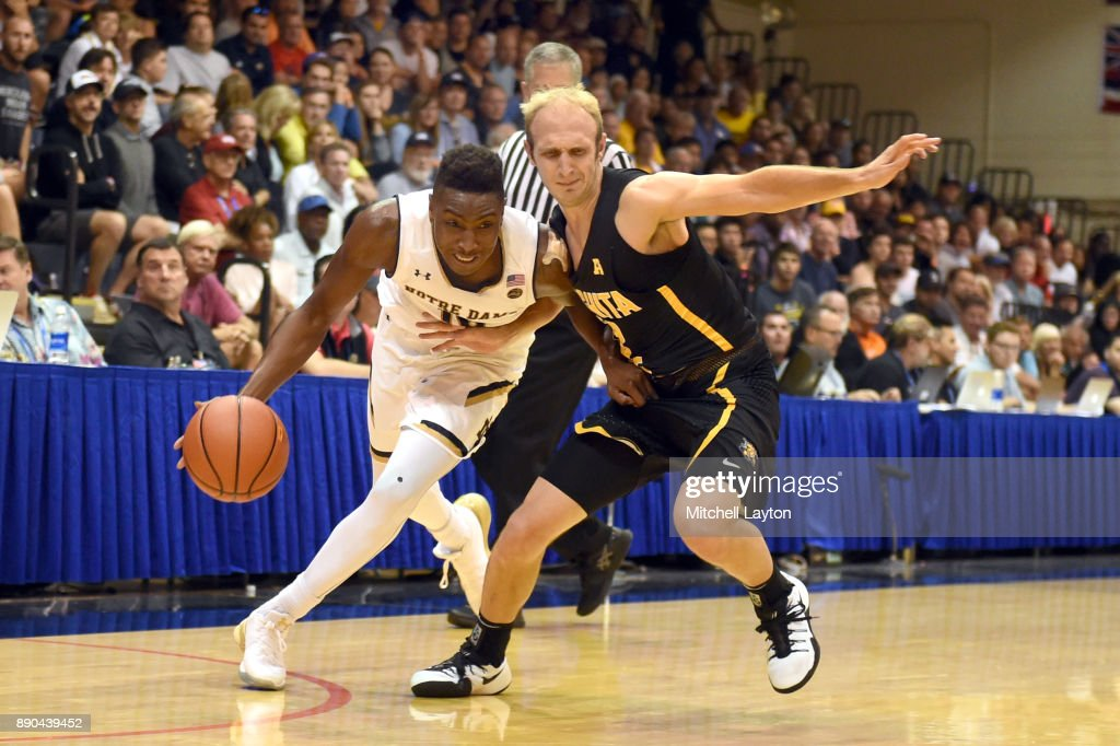 TJ Gibbs #10 of the Notre Dame Fighting Irish dribbles around Landry Shamet #11 of the Wichita State Shockers during a the championship of the Maui Invitational college basketball game at the Lahaina Civic Center on November 22, 2017 in Lahaina, Hawaii. The Fighting Irish won 67-66.