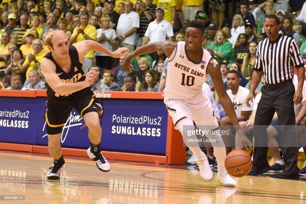 TJ Gibbs #10 of the Notre Dame Fighting Irish dribbles the ball around Conner Frankamp #33 of the Wichita State Shockers during a the championship of the Maui Invitational college basketball game at the Lahaina Civic Center on November 22, 2017 in Lahaina, Hawaii. The Fighting Irish won 67-66.