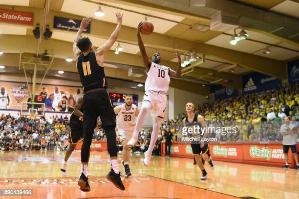 Gibbs of the Notre Dame Fighting Irish drive stop the basket over Landry Shamet of the Wichita State Shockers during a the championship of the Maui...