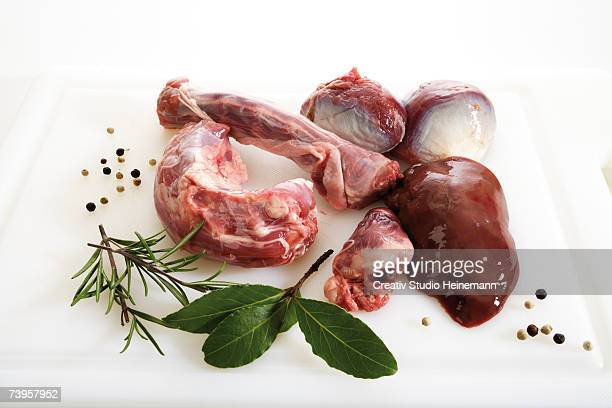 Giblets of goose on kitchen board