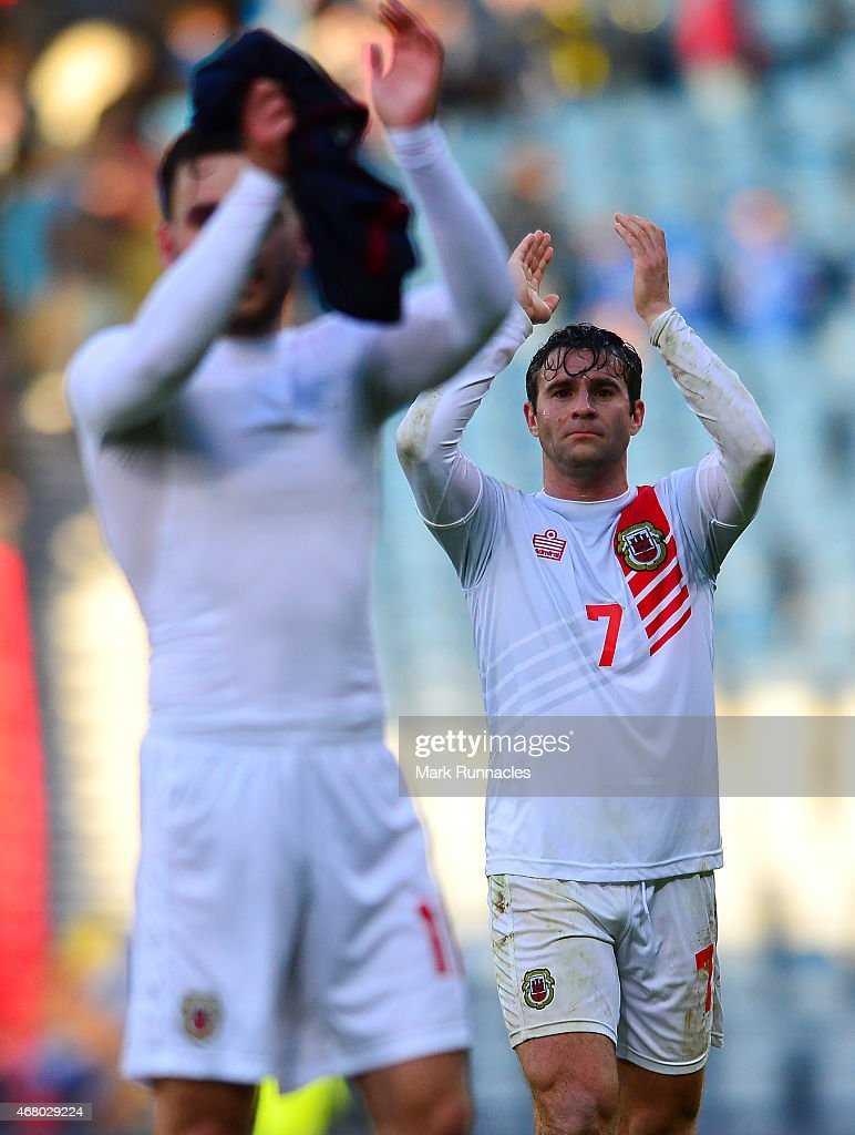 Gibraltar goal scorer Lee Casciaro acknowledges the applause from the travelling fans during the EURO 2016 Group D qualifying match between Scotland and Gibraltar at Hamden Park on March 29, 2015 in Glasgow, Scotland.