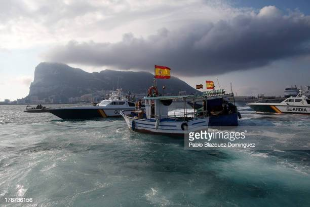 Gibraltar police boat Spanish Guardia Civil boat and Spanish fishing boats sail during a protest by Spanish fishermen in the sea near the...
