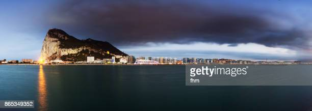 Gibraltar - view to city and rock with a large cloud (Panorama)