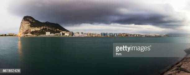 Gibraltar - view to the rock with a large cloud (Panorama)