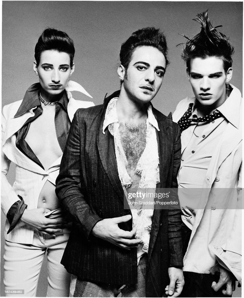 Gibraltarborn British fashion designer John Galliano with two models posed in 2001