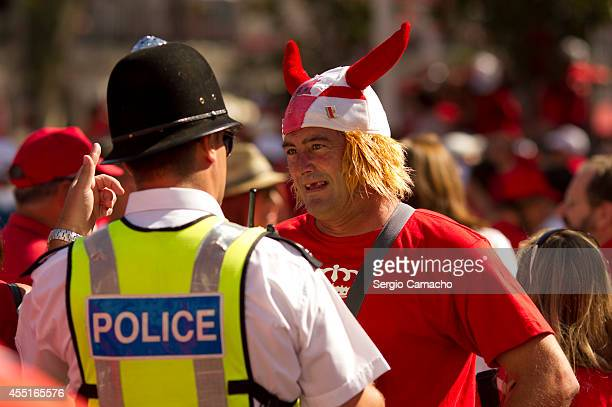 Gibraltarian and a policeman dialogue before of the rally during Gibraltar National Day celebrations on September 10 2014 in Gibraltar Gibraltar...
