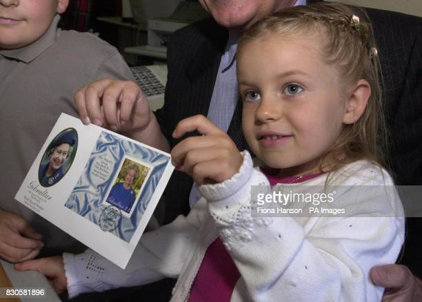 Gibraltarian Krisanne Riddell aged 4 holds the first First Day Cover 'cancelled' of the record breaking stamp to celebrate the 75th birthday of Queen...