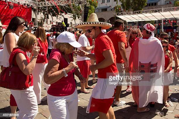 Gibraltarians dance during Gibraltar National Day celebrations on September 10 2014 in Gibraltar Gibraltar National Day is the official national day...