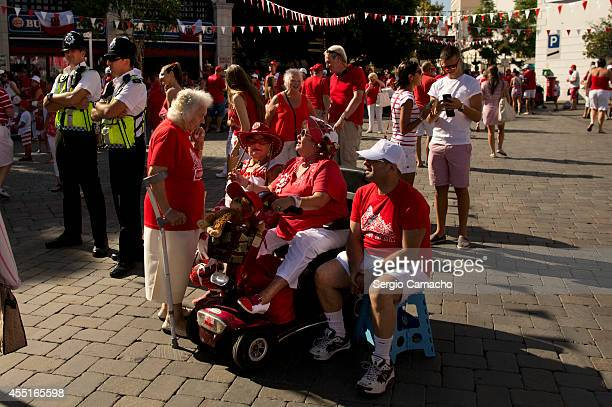 Gibraltarians dialogue before of the rally during Gibraltar National Day celebrations on September 10 2014 in Gibraltar Gibraltar National Day is the...
