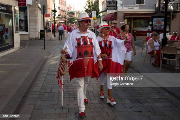 Gibraltarians walk disguised during Gibraltar National Day celebrations on September 10 2014 in Gibraltar Gibraltar National Day is the official...