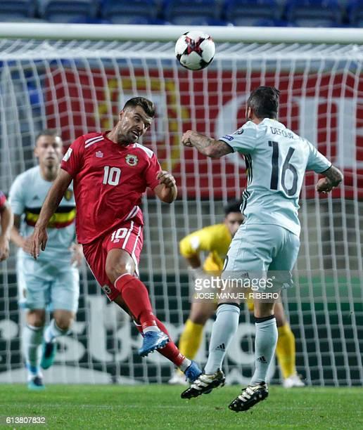 Gibraltar's midfielder Liam Walker vies with Belgium's midfielder Steven Defour during the WC 2018 football qualification match Gibraltar vs Belgium...