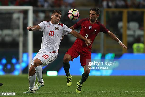 Gibraltar«s midfielder Liam Walker vies with Portugal's midfielder Joao Moutinho for the ball possession during the match between Portugal vs...