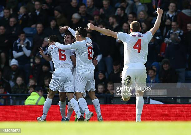 Gibraltar's players celebrate the goal scored by Gibralta's striker Lee Casciaro their first of the qualifying campaign during the Euro 2016...