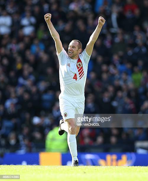 Gibralta's defender David Artell celebrates the goal scored by Gibralta's striker Lee Casciaro their first of the qualifying campaign during the Euro...