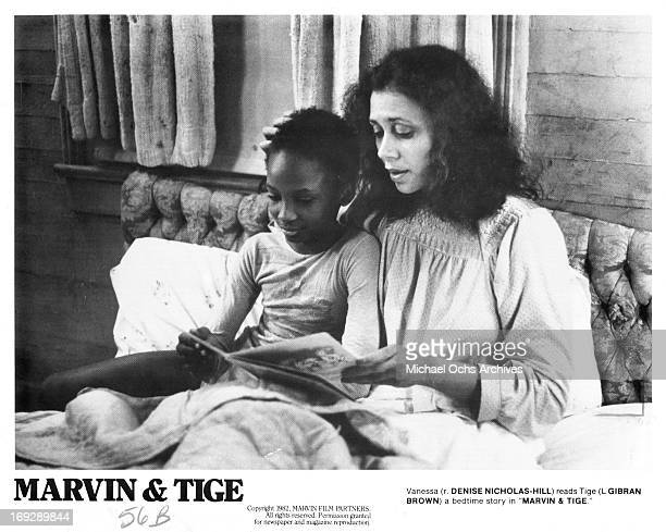 Gibran Brown is read bed time story by Denise NicholasHill in a scene from the film 'Marvin Tige' 1982