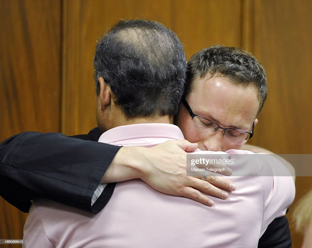 Giddings' boyfriend David Vandiver Father Dawid Kwiatkowski and hug in the courtroom after Stephen McDaniel plead guilty in court Monday morning.