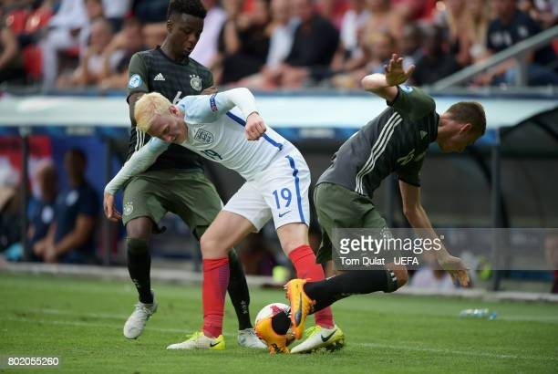 Gideon Jung of Germany and Janik Haberer of Germany attempt to get the ball from Will Hughes of England during the UEFA European Under21 Championship...
