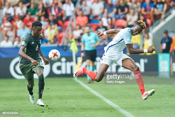 Gideon Jung of Germany tackles Tammy Abraham of England during the UEFA European Under21 Championship Semi Final match between England and Germany at...