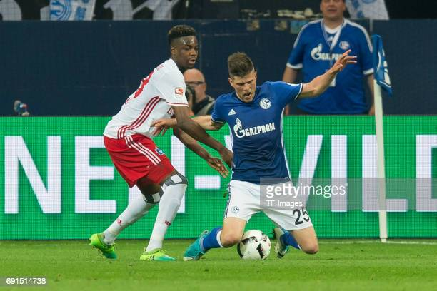 Gideon Jung of Hamburg and KlaasJan HUNTELAAR of Schalke battle for the ball during to the Bundesliga match between FC Schalke 04 and Hamburger SV at...