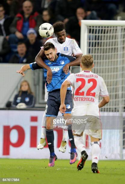 Gideon Jung of Hamburg and Lukas Rupp of Hoffenheim battle for the ball during the Bundesliga match between TSG 1899 Hoffenheim and Hamburger SV at...