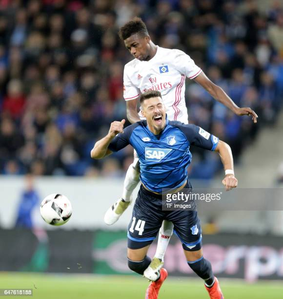 Gideon Jung of Hamburg and Sandro Wagner of Hoffenheim battle for the ball during the Bundesliga match between TSG 1899 Hoffenheim and Hamburger SV...