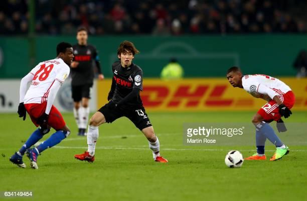 Gideon Jung of Hamburg and Yuya Osako of Koeln battle for the ball during the DFB Cup round of 16 match between Hamburger SV and 1 FC Koeln at...