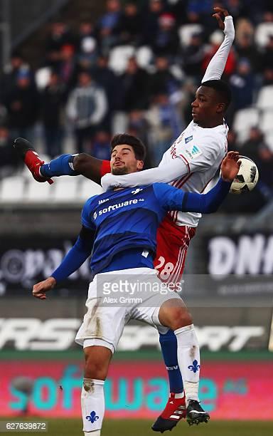 Gideon Jung of Hamburg challenges AntonioMirko Colak of Darmstadt during the Bundesliga match between SV Darmstadt 98 and Hamburger SV at Stadion am...