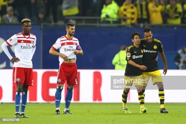 Gideon Jung of Hamburg Mergim Mavraj of Hamburg and goal scorers Shinji Kagawa of Dortmund and PierreEmerick Aubameyang of Dortmund during the...
