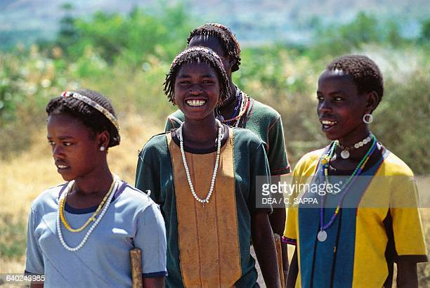 Gidole girls wearing a traditional headdress and necklaces Rift Valley Ethiopia