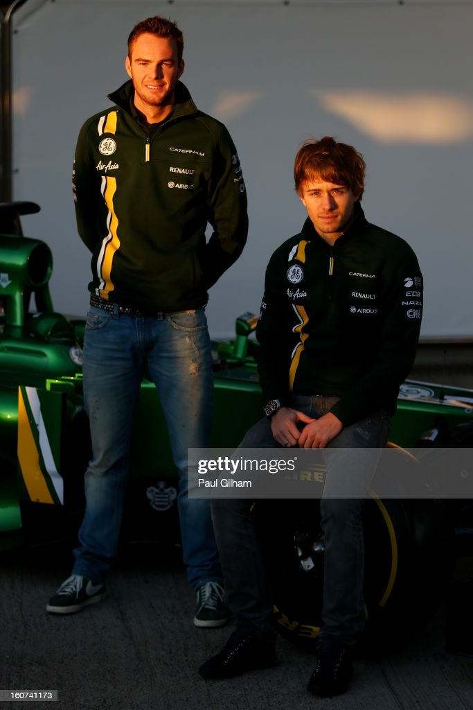 Giedo van der Garde of Netherlands and Caterham and Charles Pic of France and Caterham pose next to the CT03 car at the Caterham F1 launch during...