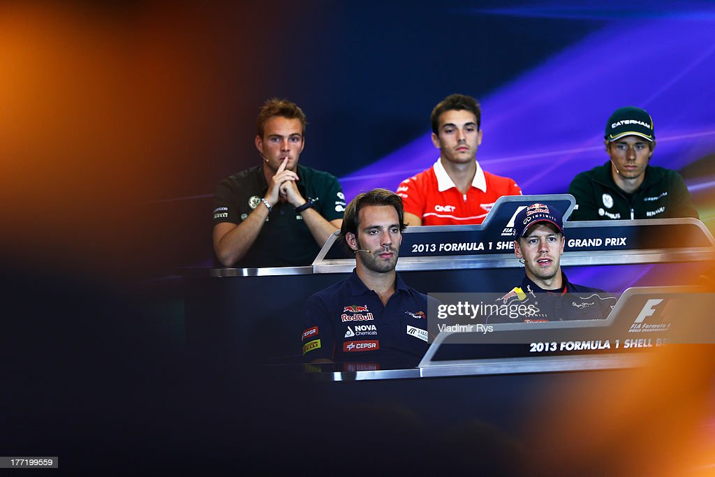 Giedo van der Garde of the Netherlands and Caterham, Jules Bianchi of France and Marussia, Charles Pic of France and Caterham, (Front row L-R) Jean-Eric Vergne of France and Scuderia Toro Rosso, Sebastian Vettel of Germany and Infiniti Red Bull Racing and Romain Grosjean of France and Lotus attend the drivers press conference during previews to the Belgian Grand Prix at Circuit de Spa-Francorchamps on August 22, 2013 in Spa, Belgium.