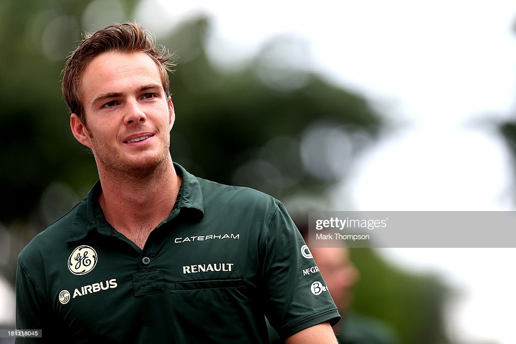 Giedo van der Garde of the Netherlands and Caterham walks through the paddock during previews for the Singapore Formula One Grand Prix at Marina Bay...