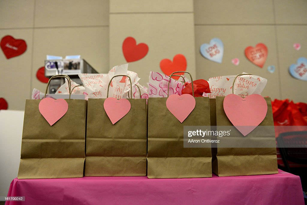 Gift bags sit on a table during a Valentine's Day marriage celebration at the Denver Clerk and Recorder's office. Couples applying for marriage licenses received gift bags containing gift certificates to local restaurants among other treats to celebrate their union.