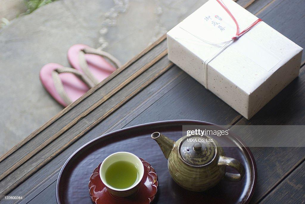 Gift box and tea cup on veranda : Stock Photo