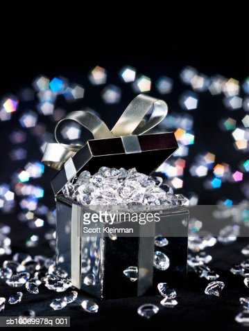 Gift box filled with diamonds, studio shot : Stock Photo