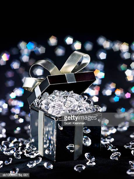 Gift box filled with diamonds, studio shot