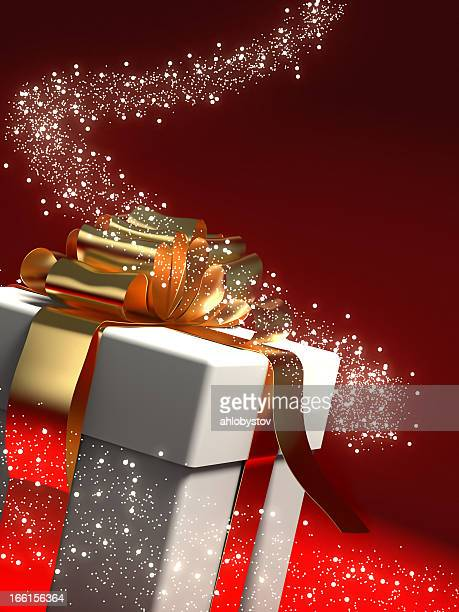 A gift box in a swirl of sparkling stars