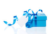 Gift Box with blue bow isolated on white
