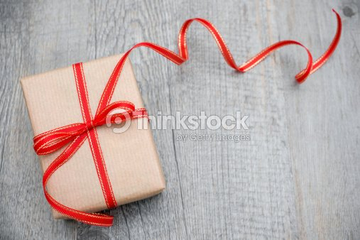 Gift box with red bow : Stock Photo