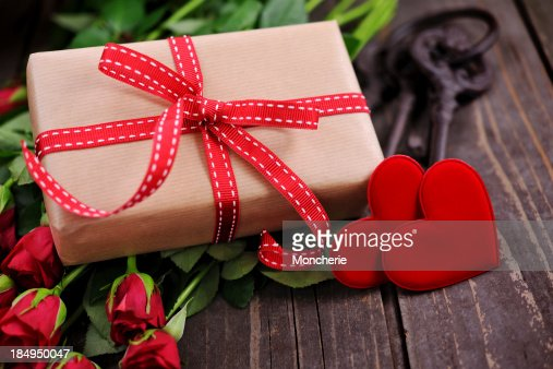 Gift box with two red hearts and roses