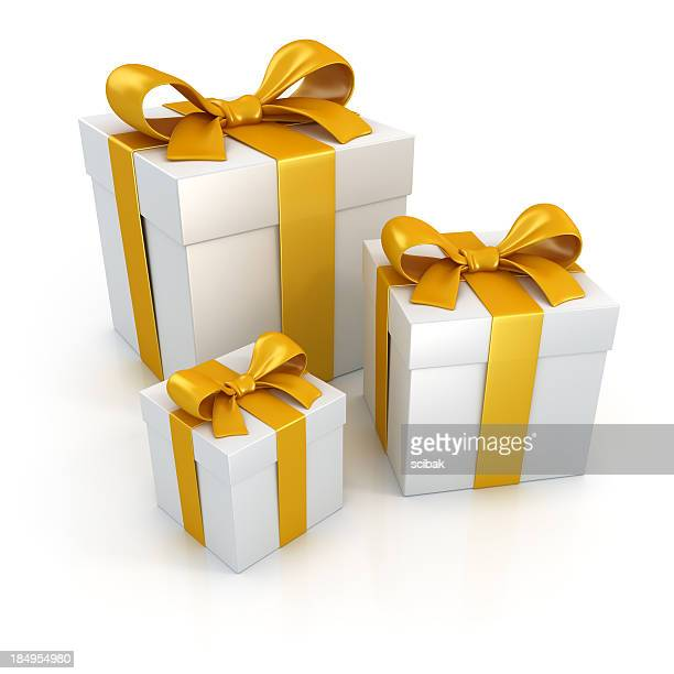 Gift boxes with gold ribbons isolated on white