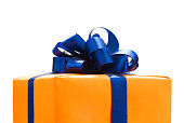 Gift boxes wrapped in Orange paper, blue color ribbon and bow ,Isolated on white with clipping path. for anniversary, new year, christmas, birth day