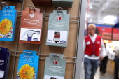 Gift cards for Lowe's are displayed on a rack during the grand opening of the Lowe's store on November 4 2010 in San Francisco California San...