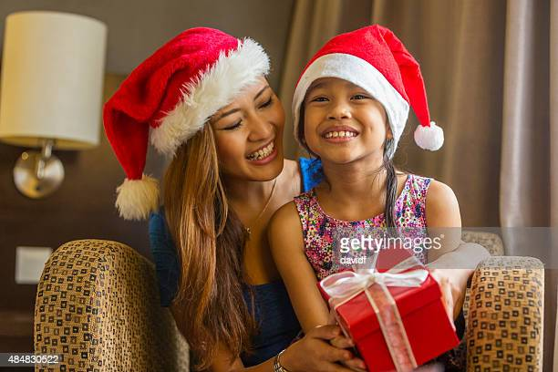 Gift Giving From Happy Asian Mother and Daughter at Christmas